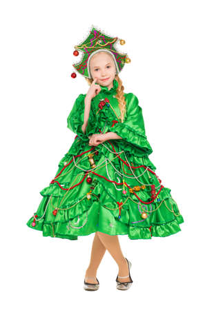 Pretty smiling girl wearing like a christmas tree. Isolated on white