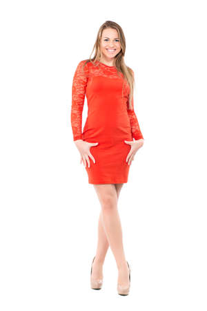 slinky: Cheerful young blond woman wearing slinky red dress. Isolated on white