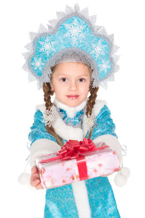 snegurochka: Little girl in traditional christmas costume with a gift box. Isolated on white