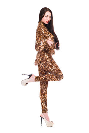 Attractive young brunette dressed as leopard. Isolated on white photo