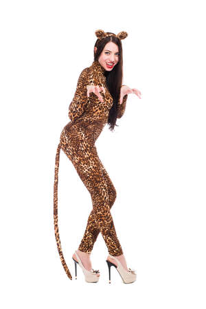 Cheerful young woman posing in leopard suit. Isolated on white photo