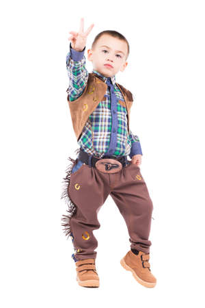Little boy posing in cowboy costumes. Isolated on white photo