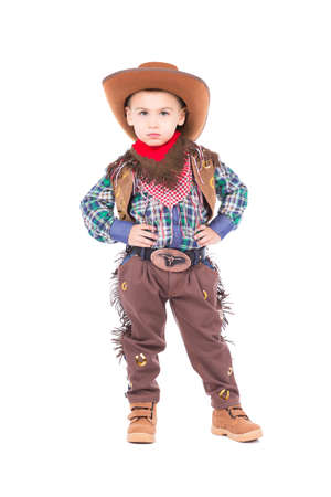Little boy wearing cowboy suit. Isolated on white photo