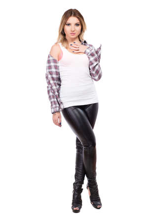 Tempting blonde wearing checked shirt and black pants. Isolated on white photo