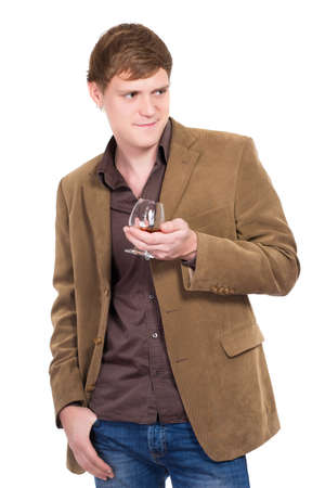 Handsome man posing with a glass of whiskey. Isolated on white photo