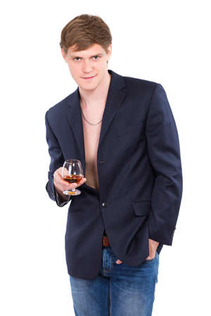 Young man posing with a glass of whiskey. Isolated photo