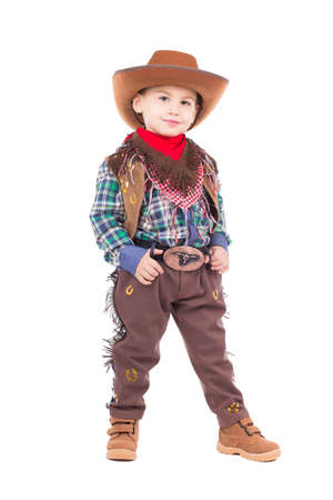 Beautiful little boy posing in cowboy costumes. Isolated on white