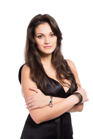 Portrait of sexy thoughtful brunette posing in black dress.