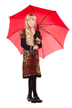 Little blond girl posing with red umbrella. Isolated on white Фото со стока