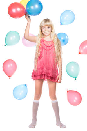 Cheerful little girl posing with balloons. Isolated on white Stock Photo