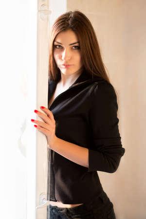 Portrait of beautiful brunette near the window Stock Photo