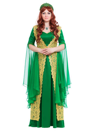 Elegant young woman wearing emerald long dress. Isolated on white photo