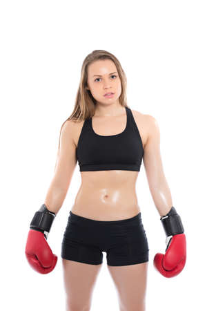 Young blond woman posing with red boxing gloves. Isolated on white photo