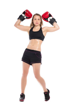Young woman posing with big red boxing gloves. Isolated on white