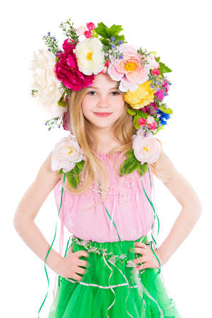 Portrait of little girl posing with a wreath on her head. Isolated