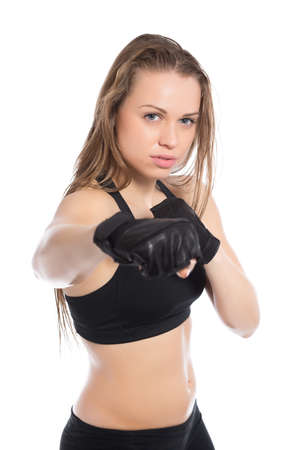 Portrait of young woman boxing in the studio. Isolated on white photo