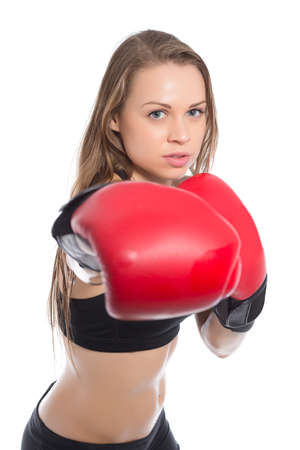 brawny: Portrait of young woman boxing. Isolated on white