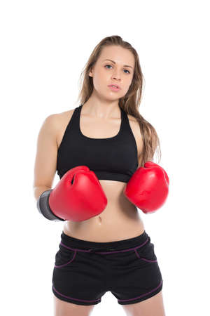brawny: Portrait of young woman posing in big red boxing gloves. Isolated on white Stock Photo