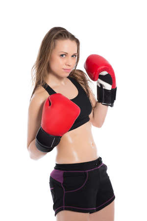 brawny: Young playful woman posing with red boxing gloves. Isolated on white