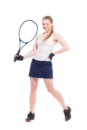 tennis skirt: Young smiling woman posing with tennis racket. Isolated on white