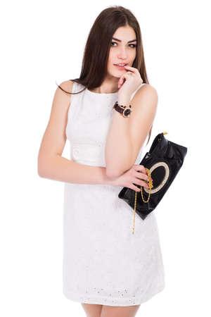 Portrait of smiling brunette posing in white dress. Isolated on white