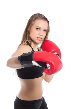 brawny: Pretty woman posing with boxing gloves. Isolated on white