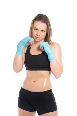 brawny: Pretty young woman posing in a boxing stand. Isolated on white