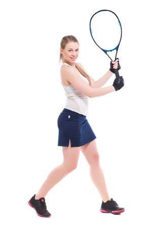 tennis skirt: Cheerful blond woman posing with tennis racket. Isolated on white Stock Photo