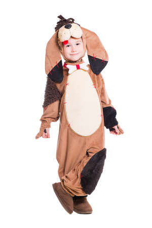 dog in costume: Funny little boy posing in a dog costume. Isolated on white