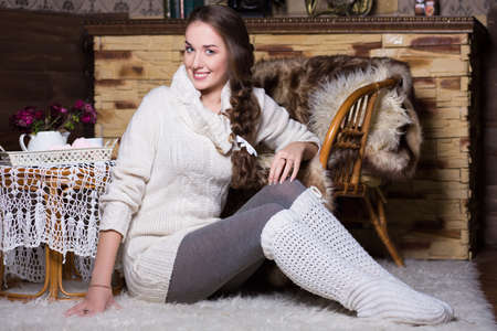 gaiters: Smiling woman in white stockings and blouse sitting on the carpet