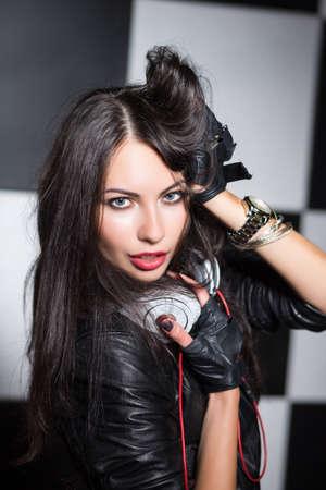 tempting: Portrait of tempting brunette posing with headphones in the studio Stock Photo