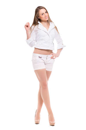 slinky: Beautiful blond woman wearing white shirt and shorts. Isolated on white