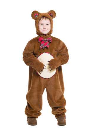 Cute little boy posing in a bear costume. Isolated on white photo