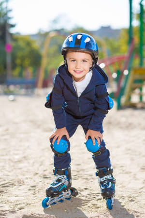 boy skater: Smiling skater boy posing on the playground