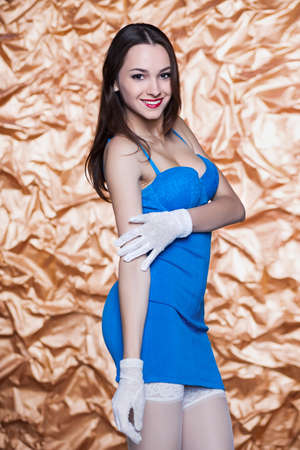 short gloves: Portrait of young sexy woman posing in blue dress and white gloves