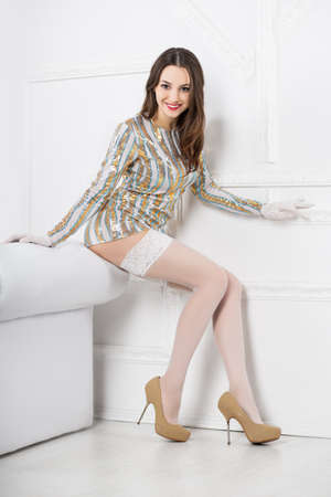 frank: Young smiling woman wearing frank dress and white stockings