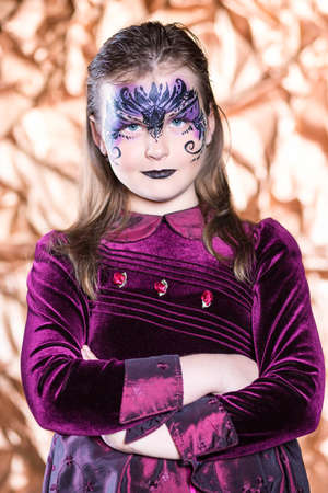 painted face: Portrait of attractive little girl with painted face