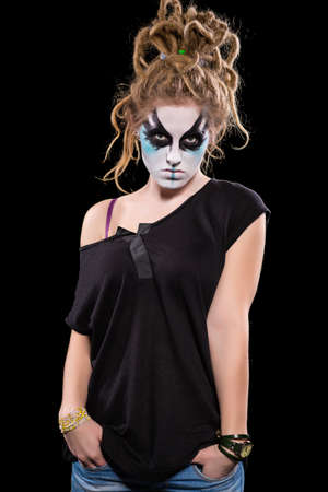 Portrait of young woman with scary makeup for Halloween. Isolated on black Stock Photo