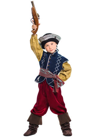 Young boy dressed as pirate posing holding the gun over his head. Isolated on white