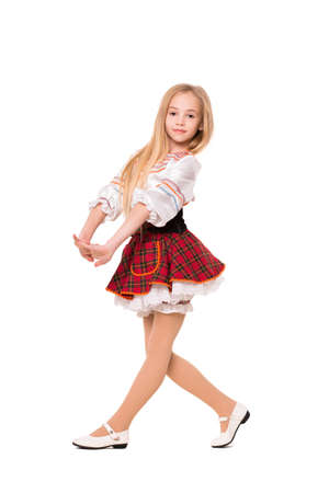 fashion clothing: Little blond girl wearing short dress and dancing. Isolated on white