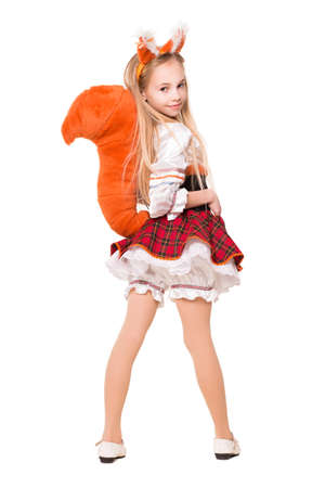 furry animals: Niza niña que llevaba como una ardilla que muestra su cola. Aislado en blanco Foto de archivo