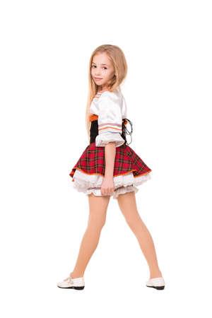 back posing: Little blond girl posing in short red dress. Isolated on white