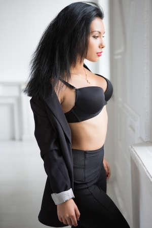 black bra: Young sexy brunette in black bra posing near the window
