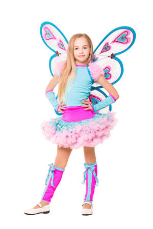 Pretty little girl wearing like a butterfly. Isolated on white photo