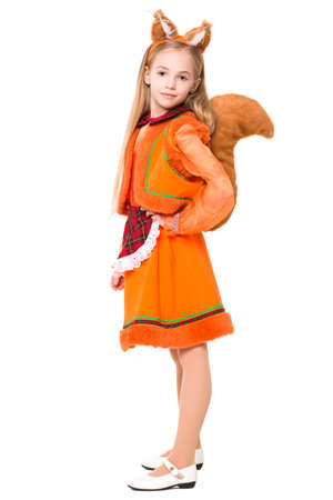 Little girl posing in a squirrel dress. Isolated on white photo