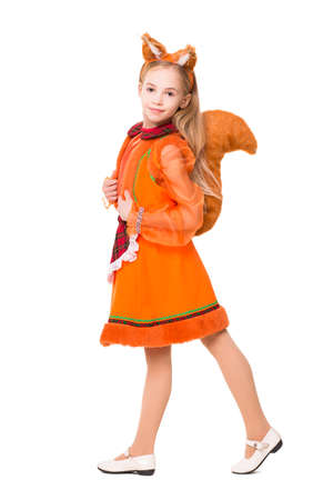 Pretty blond girl dressed like a squirrel. Isolated on white photo