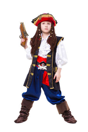 Little boy dressed as medieval pirate posing with a gun. Isolated on white