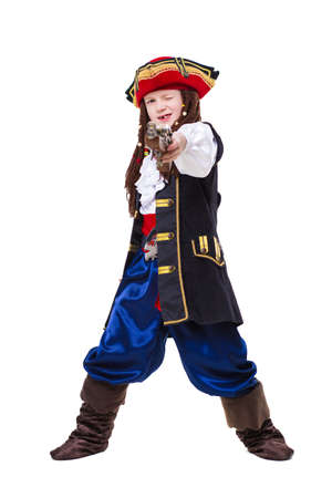 A funny boy dressed as pirate posing in the studio. Isolated on white