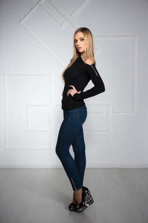 sexual girl: Charming young woman posing in blue jeans and black blouse