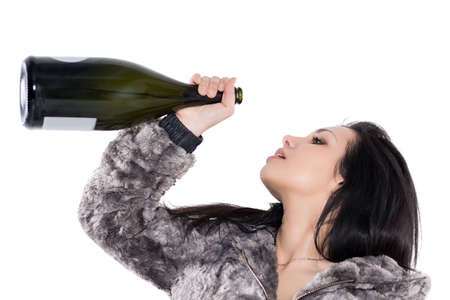 Portrait of sexy brunette with a big bottle. Isolated on white Stock Photo